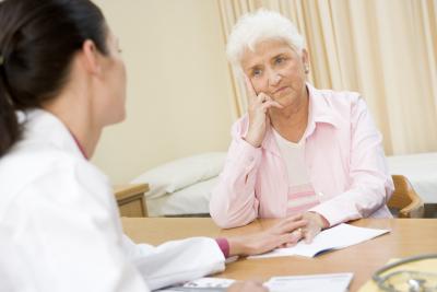 senior woman and nurse