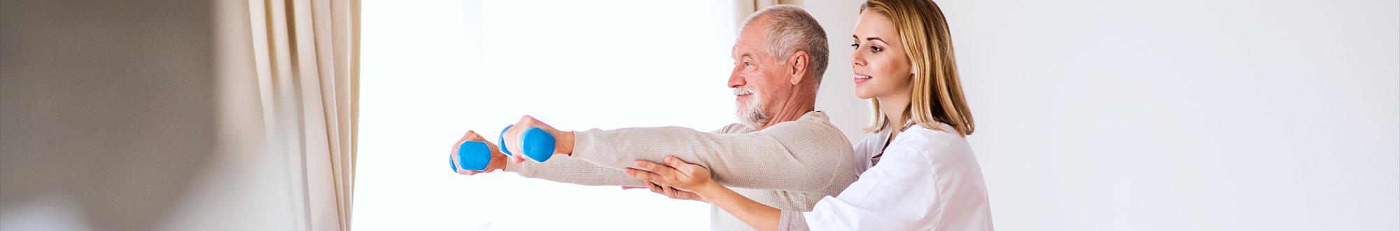 caregiver and senior man exercising